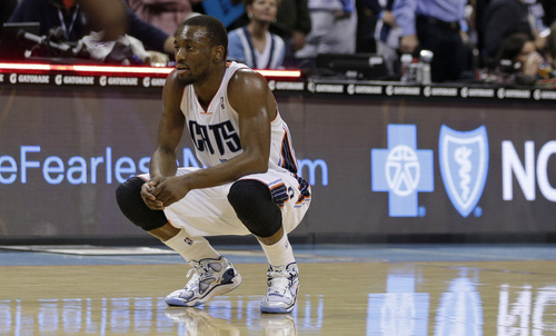 Charlotte Bobcats' Kemba Walker looks down the court after an NBA basketball game against the Utah Jazz in Charlotte, N.C., Saturday, Dec. 21, 2013. The Jazz won 88-85. (AP Photo/Chuck Burton)