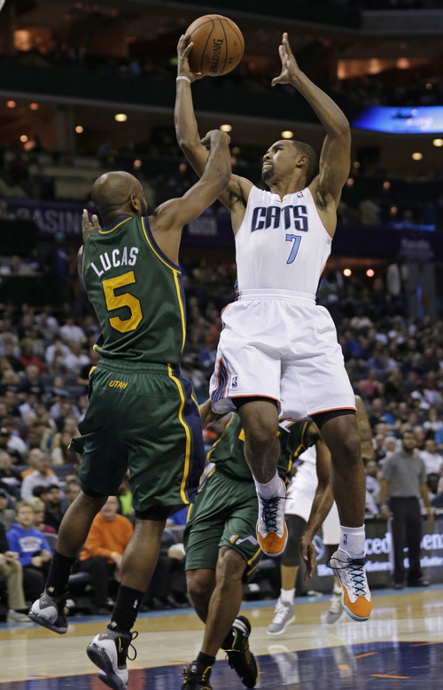 Charlotte Bobcats' Ramon Sessions (7) shoots over Utah Jazz's John Lucas III (5) during the second half of an NBA basketball game in Charlotte, N.C., Saturday, Dec. 21, 2013. The Jazz won 88-85. (AP Photo/Chuck Burton)