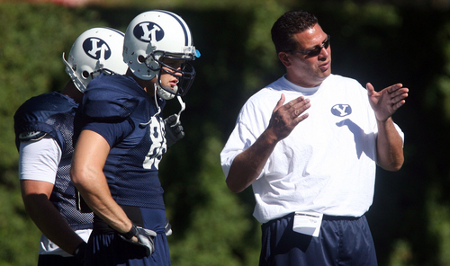 Tribune file photo Robert Anae, seen at a team practice in 2006, is back as BYU's offensive coordinator and is installing an uptempo attack as the Cougars prepare for the 2013 season.