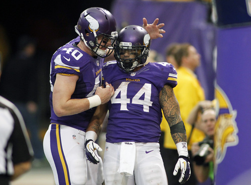 Minnesota Vikings running back Matt Asiata (44) celebrates with teammate Rhett Ellison after scoring on a 1-yard touchdown run during the second half of an NFL football game against the Philadelphia Eagles, Sunday, Dec. 15, 2013, in Minneapolis. (AP Photo/Andy King)
