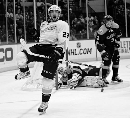 Anaheim Ducks' Mathieu Perreault (22) celebrates his goal against New York Islanders goalie Evgeni Nabokov (20) as Travis Hamonic (3) looks away during the period of an NHL hockey game Saturday, Dec. 21, 2013, in Uniondale, N.Y. The Ducks won 5-3. (AP Photo/Kathy Kmonicek)