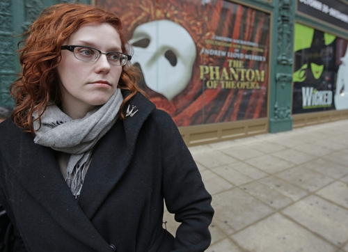 FILE - In this Dec. 3, 2013 file photo, actor Adrienne Matzen poses in Chicago's theater district. Matzen, 29, who has been mostly uninsured since she turned 21, is now looking for a low monthly premium insurance plan on the federal website. High deductibles for health plans available on the Illinois insurance exchange may contribute to sticker shock when people start paying medical bills in 2014, if they have elected to pay for insurance under the Affordable Care Act. (AP Photo/M. Spencer Green)