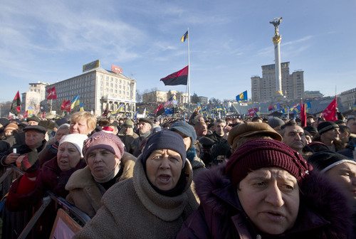 Pro-European Union activists gather in Independence Square in Kiev, Ukraine, Sunday, Dec. 22, 2013. Ukraine has been stricken with mass protests for over a month, as protesters demand the resignation of President Viktor Yanukovych over his decision to ditch a pact with the European Union in favor of closer ties with Russia. Independence Column at back right. (AP Photo/Efrem Lukatsky)