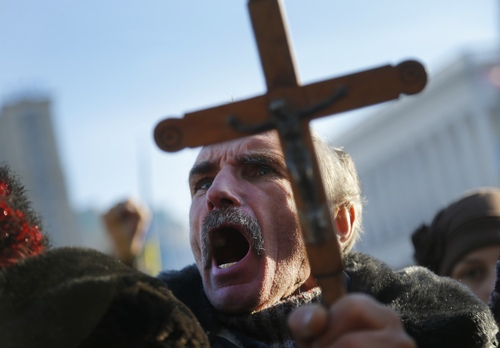 A pro-European Union activist attends a rally in Independence Square in Kiev, Ukraine, Sunday, Dec. 22, 2013. Protesters in Kiev are demanding President Viktor Yanukovych's resignation over his decision to ditch a pact with the European Union in favor of closer ties with Russia. (AP Photo/Sergei Grits)