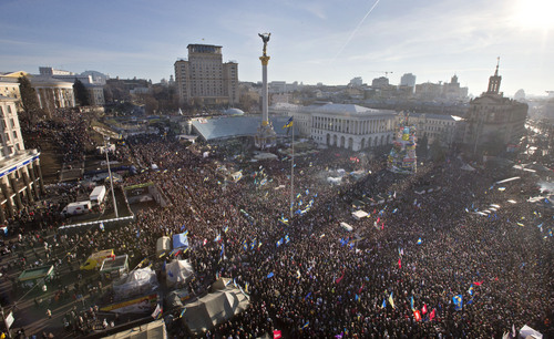 Pro-European Union activists gather in Independence Square in Kiev, Ukraine, Sunday, Dec. 22, 2013. Ukraine has been stricken with mass protests for over a month.  Protesters are demanding the resignation of President Viktor Yanukovych over his decision to ditch a pact with the European Union in favor of closer ties with Russia. (AP Photo/Efrem Lukatsky)