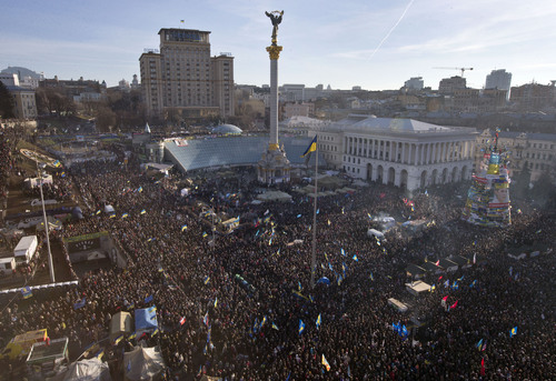 Pro-European Union activists gather during a rally in Independence Square in Kiev, Ukraine, Sunday, Dec. 22, 2013. Ukraine has been stricken with mass protests for over a month.  Protesters are demanding President Viktor Yanukovych's resignation over his decision to ditch a pact with the European Union in favor of closer ties with Russia. (AP Photo/Efrem Lukatsky)
