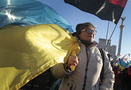 A pro-European Union activist attends a rally in Independence Square in Kiev, Ukraine, Sunday, Dec. 22, 2013. Protesters in Kiev are demanding President Viktor Yanukovych's resignation over his decision to ditch a pact with the European Union in favor of closer ties with Russia. (AP Photo/Sergei Chuzavkov)