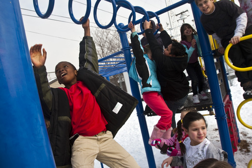 Chris Detrick  |  The Salt Lake Tribune  Third grader Ariside Gateretse, left, and other students play on the playground during recess at Hawthorne Elementary in Salt Lake City Tuesday January 4, 2011.  The Utah Department of Health advises schools to keep children sensitive to poor air, including those with asthma, indoors during recess. Other students are allowed to play outside. The state has an air quality monitor in the northeast corner of the campus at Hawthorne.