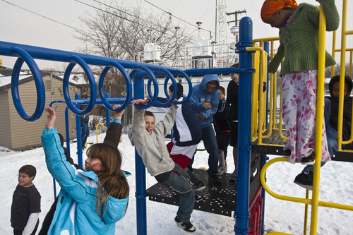 Chris Detrick  |  The Salt Lake Tribune  Students play on the playground during recess at Hawthorne Elementary in Salt Lake City Tuesday January 4, 2011.  The Utah Department of Health advises schools to keep children sensitive to poor air, including those with asthma, indoors during recess. Other students are allowed to play outside. The state has an air quality monitor in the northeast corner of the campus at Hawthorne.