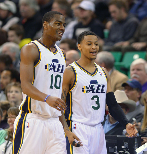 Steve Griffin  |  The Salt Lake Tribune   Utah Jazz point guard Alec Burks (10) and Utah Jazz point guard Trey Burke (3) laugh as they take the court following a time out during first half action in the Utah Jazz versus Indiana Pacers at EnergySolutions Arena in Salt Lake City, Utah Wednesday, December 4, 2013.