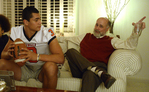 Rick Egan  | The Salt Lake Tribune   Chris Lindstrom chats with his grandson, Brighton High football star, Osa Masina at his home, Wednesday, December 18, 2013. Brighton RB/LB Osa Masina has been selected as MVP of the first-ever All-Tribune team.