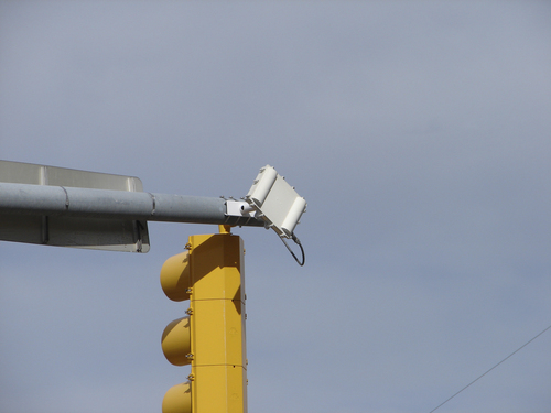 | Courtesy Utah Department of Transportation Small radar units attached to traffic signals help UDOT determine how many cars are stopped by red lights, and their speeds through intersections. The data helps UDOT improve the timing of lights.