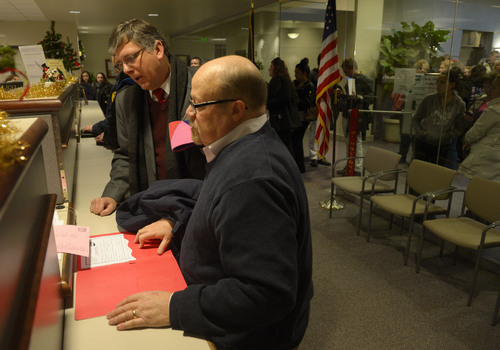 Steve Griffin  |  The Salt Lake Tribune   Gage Church, left, and Tim Sharp fill out paper work as they get their marriage license at the Weber County Clerk's Office in Ogden, Utah Monday, December 23, 2013.