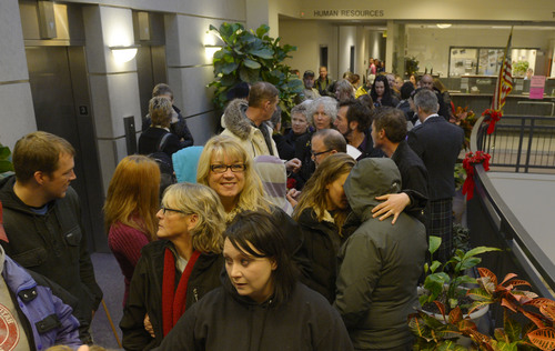 Steve Griffin  |  The Salt Lake Tribune   Couples wait in line to get their marriage license at the Weber County Clerk's Office in Ogden, Utah Monday, December 23, 2013.