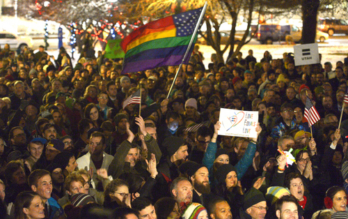 Rick Egan  | The Salt Lake Tribune   Crowds cheer during the ìCelebrate Marriage Equality Rallyî at Washington Square,Monday, December 23, 2013.