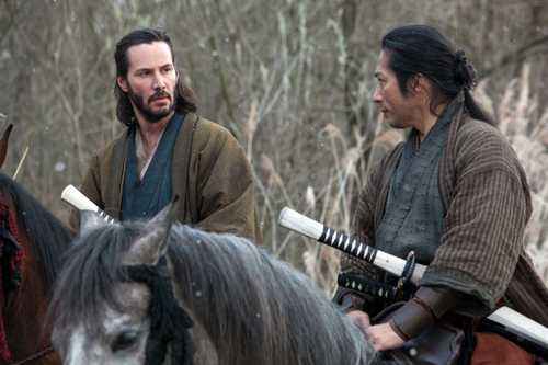 """This image released by Universal Pictures shows Keanu Reeves, left, and Hiroyuki Sanada in a scene from """"47 Ronin."""" (AP Photo/Universal Pictures, Frank Connor)"""