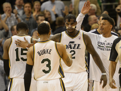 Rick Egan  | The Salt Lake Tribune   Utah Jazz point guard Trey Burke (3) congratulates Utah Jazz power forward Marvin Williams (2) after Williams stoled the ball, and hit a big basket giving the Jazz a 5 point lead with less than a minute left in the game,  in NBA action, Utah Jazz vs. the Houston Rockets, at the EnergySolutions Arena, Monday, December 2, 2013.