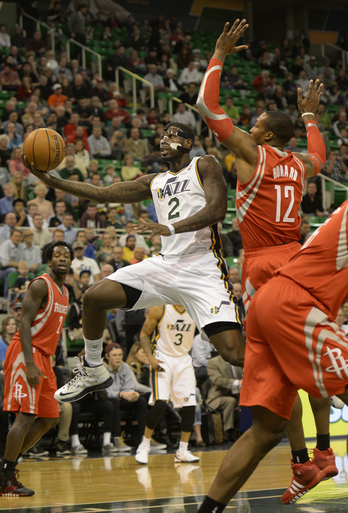 Rick Egan  | The Salt Lake Tribune   Utah Jazz power forward Marvin Williams (2) gets past Houston Rockets power forward Dwight Howard (12),  in NBA action, Utah Jazz vs. the Houston Rockets, at the EnergySolutions Arena, Monday, December 2, 2013.