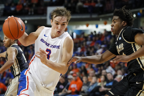 Boise State's Anthony Drmic (3) drives the ball against Idaho's Mike Scott during the first half of an NCAA college basketball game in Boise, Idaho, Wednesday, on Nov. 27, 2013. Boise State beat Idaho 98-89. (AP Photo/Otto Kitsinger)