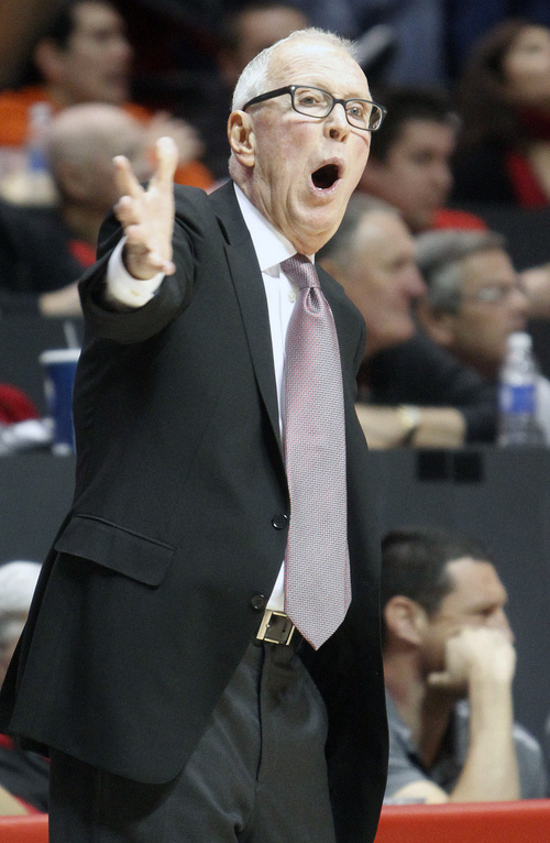 San Diego State head coach Steve Fisher calls out to his team during during the first half of NCAA college basketball game against Washington on Sunday, Dec. 8, 2013, in San Diego. (AP Photo/Don Boomer)