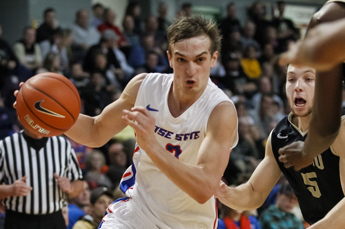 Boise State's Anthony Drmic (3) drives the ball during the second half of an NCAA college basketball game against Idaho in Boise, Idaho, Wednesday, Nov. 27, 2013. Boise State beat Idaho 98-89. (AP Photo/Otto Kitsinger)