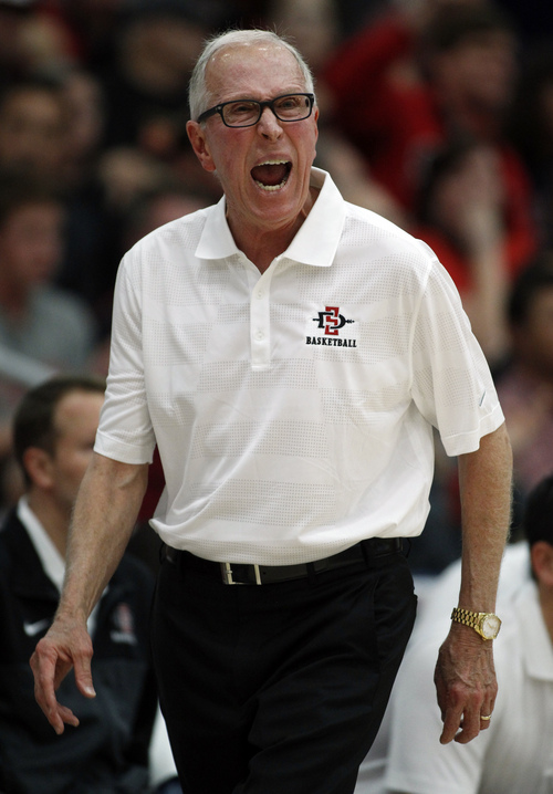 San Diego State head coach Steve Fisher shouts at his players in the first half of an NCAA college basketball semifinal game against Creighton at the Wooden Legacy tournament on Friday, Nov. 29, 2013, in Fullerton, Calif.  (AP Photo/Alex Gallardo)