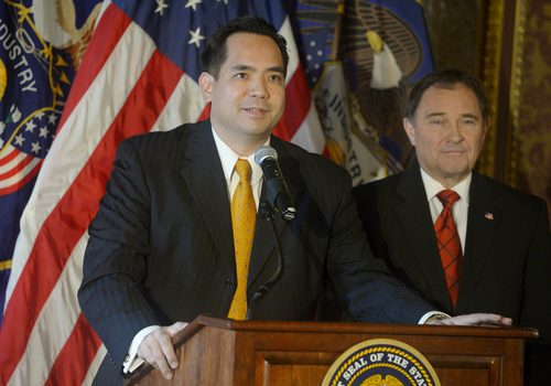 Keith Johnson | The Salt Lake Tribune  Utah Governor Gary Herbert, right, announces Sean Reyes as Utah's new Attorney General, December 23, 2013. Reyes takes office after former Attorney General John Swallow resigned amid allegations of impropriety.