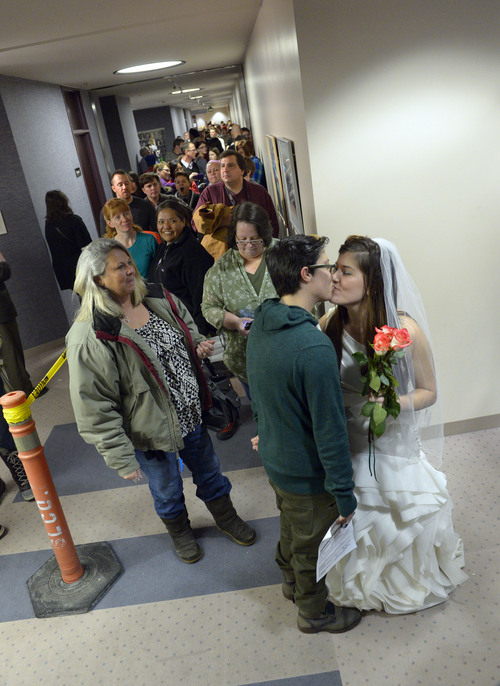 Francisco Kjolseth  |  The Salt Lake Tribune Heather Collins, in dress, gets ready to marry her partner of 6-years Jax Collins as they join hundreds of same-sex couples who descended on county clerk offices around the state of Utah on Monday, Dec. 22, 2013,  including the Salt Lake County office to request marriage licenses. A federal judge in struck down the state's ban on same-sex marriage last Friday, saying the law violates the U.S. Constitution's guarantees of equal protection and due process.
