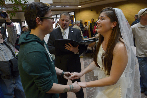 Francisco Kjolseth  |  The Salt Lake Tribune Jax Collins, left, and Heather Collins become emotional as they are married by Rev. Christopher Scuderi of Universal Heart Ministry on Monday, Dec. 23, 2013, at the Salt Lake City County offices. Hundreds of same-sex couples descended on county clerk offices around the state of Utah to request marriage licenses. A federal judge in Utah struck down the state's ban on same-sex marriage last Friday, saying the law violates the U.S. Constitution's guarantees of equal protection and due process.