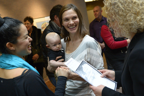 Francisco Kjolseth  |  The Salt Lake Tribune Danielle Torres, left, and partner of 7-years, Jody Jones holding their son Franti Torres-Jones, 3-months, are overjoyed with hearing the word Utah as they are married in the lobby of the Salt Lake County offices on Monday, Dec. 23, 2013. Hundreds of same-sex couples descended on county clerk offices to request marriage licenses. A federal judge in Utah struck down the state's ban on same-sex marriage last Friday, saying the law violates the U.S. Constitution's guarantees of equal protection and due process.