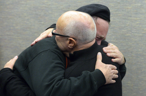 Francisco Kjolseth  |  The Salt Lake Tribune Doug White, front, embraces his partner of 18-years Kip Swan as the two are married at the Salt Lake County offices on Monday, Dec. 23, 2013. A federal judge in Utah struck down the state's ban on same-sex marriage last Friday, saying the law violates the U.S. Constitution's guarantees of equal protection and due process.