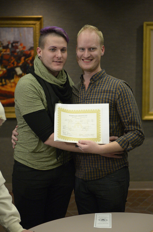 Francisco Kjolseth  |  The Salt Lake Tribune Austin Smith, left, and Arlo Vance who have been together 8-years make their union official as they join hundreds of same-sex couples who descend on county clerk offices around the state of Utah on Monday, Dec. 22, 2013,  including the Salt Lake County office to request marriage licenses. A federal judge in struck down the state's ban on same-sex marriage last Friday, saying the law violates the U.S. Constitution's guarantees of equal protection and due process.