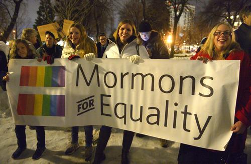 "Rick Egan  | The Salt Lake Tribune   L-R Alish Megan and Julie Ogden, Sunnyvale California, and Mikaela Dufur, Orem, hold a sign at the ""Celebrate Marriage Equality Rally"" at Washington Square,Monday, December 23, 2013."