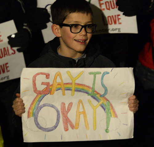 "Rick Egan  | The Salt Lake Tribune   Nine-year-old Tarek Rojas, Sandy, holds a sign at the ""Celebrate Marriage Equality Rally"" at Washington Square,Monday, December 23, 2013."