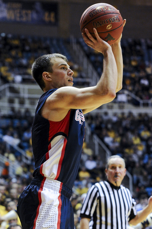 Gonzaga's Kevin Pangos (4) looks to shoot during the second half of an NCAA college basketball game against West Virginia, Tuesday, Dec. 10, 2013, in Morgantown, W.Va. Gonzaga won 80-76. (AP Photo/Andrew Ferguson)