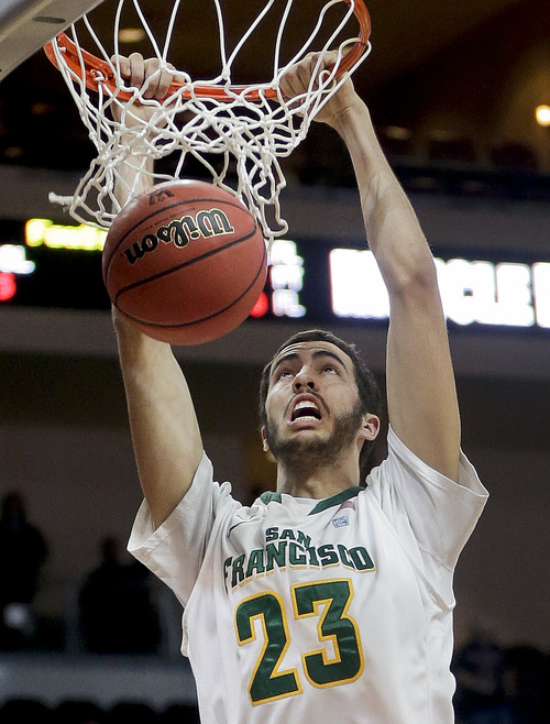 San Francisco's Cole Dickerson dunks against Loyola Marymount in the first half of a West Coast Conference tournament NCAA college basketball game, Thursday, March 7, 2013, in Las Vegas. (AP Photo/Julie Jacobson)