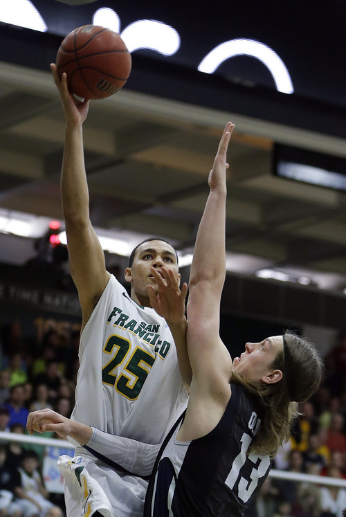 San Francisco's Cole Dickerson, left, shoots over Gonzaga's Kelly Olynyk (13) during the first half of an NCAA college basketball game, Saturday, Feb. 16, 2013, in San Francisco. (AP Photo/Ben Margot)