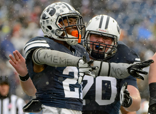 Trent Nelson  |  The Salt Lake Tribune Brigham Young Cougars running back Jamaal Williams (21) celebrates a tochdown as BYU hosts Idaho State, college football at LaVell Edwards Stadium in Provo, Saturday November 16, 2013.