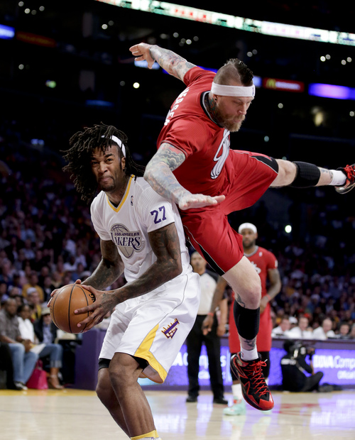 Miami Heat forward Chris Andersen, right, fouls Los Angeles Lakers center Jordan Hill during the first half of an NBA basketball game in Los Angeles, Wednesday, Dec. 25, 2013. (AP Photo/Chris Carlson)