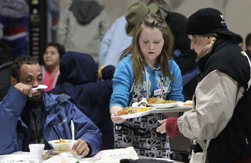 Leah Hogsten  |  The Salt Lake Tribune For the 2nd year, Stahlie Singleton, 12 serves dinners to the needy Wednesday, December 25th with her family. The Singletons have not bought each other Christmas presents this year and have decided to donate the money they would've spent on needy families and volunteer their time.  On Christmas Day, the Salt Lake City Rescue Mission served dinner to those in need at The Christian Life Center.