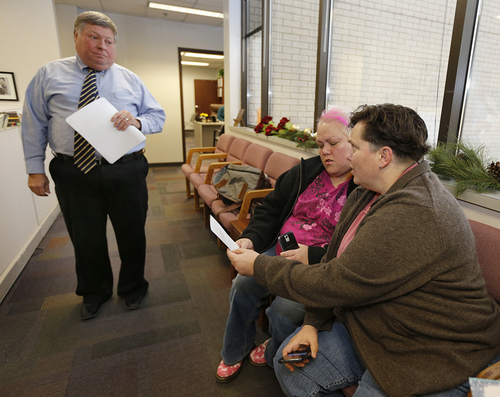 Utah County Clerk and Auditor Bryan Thompson Left, hands out rejection letter for a marriage license to Raylynn Marvel Center, and Patsy Carter right, from Orem, Utah, in the offices of the Utah County Clerk and Auditor office on Dec. 20, 2013 in Provo, Utah. A Federal Judge on Friday struck down Utah's ban on same sex marriage saying the law violates the U.S. Constitution.  (Photo by George Frey  |  Special to the Tribune)