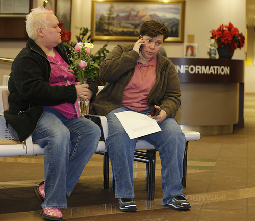 Patsy Carter left, and Raylynn Marvel  right, from Orem, Utah, talk on the phone outside the offices of the Utah County Clerk and Auditor office and hold a rejection letter for a marriage license on Dec. 20, 2013 in Provo, Utah. A Federal Judge on Friday struck down Utah's ban on same sex marriage saying the law violates the U.S. Constitution.  (Photo by George Frey  |  Special to the Tribune)