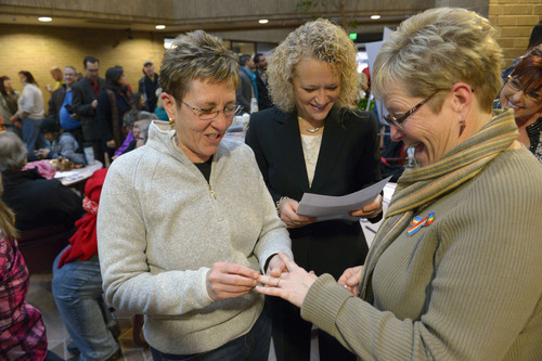 Francisco Kjolseth  |  The Salt Lake Tribune Joyce Lewallen, left, marries her partner of 20-years Lecia Johnson as Jackie Biskupski officiates on Monday, Dec. 23, 2013. Hundreds of same-sex couples descended on county clerk offices around the state of Utah,  including the Salt Lake County office to request marriage licenses. A federal judge in struck down the state's ban on same-sex marriage last Friday, saying the law violates the U.S. Constitution's guarantees of equal protection and due process.