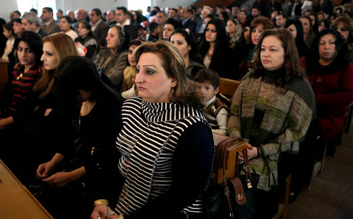 Iraqi Christians attend a Christmas mass at the Mother Teresa Catholic Church in Basra, Iraq's second-largest city, 340 miles (550 kilometers) southeast of Baghdad, Iraq, Wednesday, Dec 25, 2013. Iraqi officials say a car bomb went off near a Baghdad church during Christmas Mass, more than a dozen people. (AP Photo/Nabil al-Jurani)