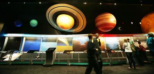 Steve Griffin | The Salt Lake Tribune   Patrons walk under the Solar System at the Clark Planetarium at The Gateway in Salt Lake City, Utah Tuesday March 26, 2013.