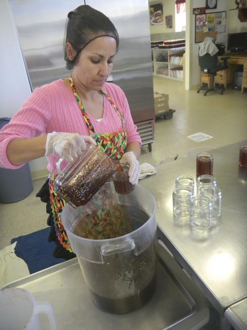 Elma Portilla bottles Pepperlane jelly at Wanship plant. (Tom Wharton Photo)