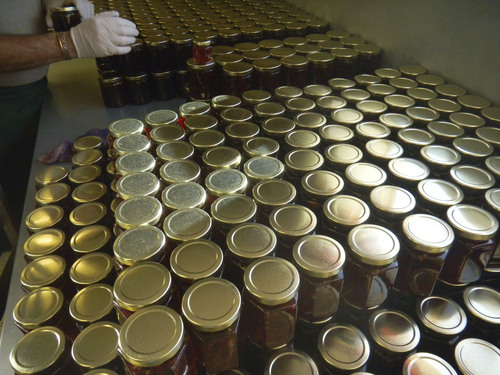 Dozens of bottles of Pepperlane jellies are getting prepared for shipment to 17 states and numerous Utah stores. (Tom Wharton Photo)