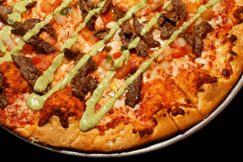 Trent Nelson  |  The Salt Lake Tribune Top Utah dishes of 2013: The carne asada pizza at Spedelli's, a Salt Lake City Pizza Parlor and bar.