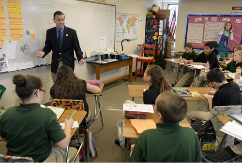 Rick Egan  | The Salt Lake Tribune   West Valley City Mayor Mike Winder helps sixth-graders at Endeavor Hall  write letters inviting President Obama to visit Utah, Thursday, Dec. 5, 2013.