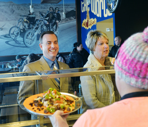Steve Griffin  |  The Salt Lake Tribune   West Valley Mayor Mike Winder smiles as he orders a burrito during a ribbon cutting ceremony for Freebirds World Burrito, in West Valley City, Utah Monday, December 9, 2013.